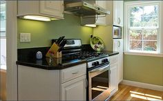 small kitchen design idea with green wall painting How to make change for green kitchen design Very Small Kitchen Design, Small Kitchen Layouts, Small Kitchen Storage, Small Space Kitchen, Small Spaces, Small Kitchens, White Kitchens, Green Kitchen Walls, New Kitchen