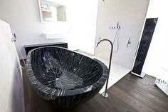 freestanding black and white bathtub from Home Gallery Design