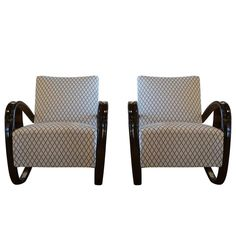 20th Century Beech bent wood Pair of Lounge Chairs, Jindrich Halabala   From a unique collection of antique and modern lounge chairs at https://www.1stdibs.com/furniture/seating/lounge-chairs/