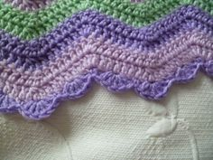 Baby Ripple Blanket Edging  Susan from the blog The 8th Gem shares a free pattern for this ripple blanket crocheted edging. Handy to know!