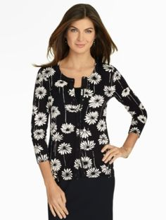 Our Charming Cardigan = a staple. Get it in this updated season-appropriate whimsical daisy print.