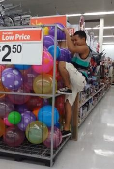 A new meme you should know about, ball pit diving at Wal-Mart