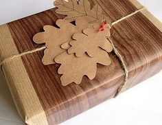 Wrapping Idea. Oak leaves gift tag. Wood effect wrapping paper. Brown paper. String.