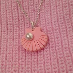 We love Lucy's snap of our Shell Charm Neck lace with a pretty pastel Topshop knit! Buy it now: http://www.tattydevine.com/shop/featured/sale/bestival-shell-charm-necklace.html