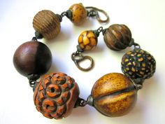 Old Business - primitive assemblage vintage graduated wood beads, chunky weathered industrial black metal soldered bracelet by LoveRoot