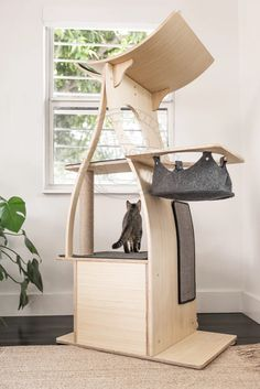 32 Cozy Cat Tree Design Ideas For Your Furry Friend - If you've ever observed an undomesticated cat, you will realize that this member of the feline family prizes her freedom. Cats love to climb, hide, ex. Cat Tree House, Cat Tree Condo, Cat Condo, Modern Cat Furniture, Condo Furniture, Cat Gym, Cat Jungle Gym, Cat Tree Designs, Cat Apartment