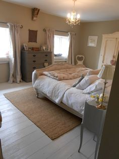Pretty bedroom complete with Peony and Sage curtains, French antique bed and furniture from French Gray.
