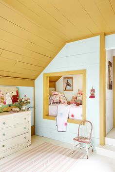 The same warm gold (Golden Bark by Benjamin Moore) appears in this room, to frame the unique bed and highlight the ceiling. The owners designed a recessed bunk, which frees up floor space.
