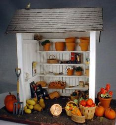 Miniature Market Stand This is another one of the first projects I completed in miniature. I built the market stand itself in a class taught in Ashland, VA in the 1990's. Nutshell News (now Dollhouse Miniatures magazine) articles taught me how to make much of the produce from FIMO. This