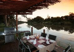 Wouldn't you also love to have a meal at this table at Bivack Bush Safari? One could not ask for a more serene view. Outdoor Seating, South Africa, Serenity, Safari, Meal, Table, Food, Tables, Desk
