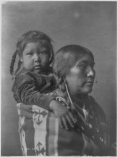 Harry High Medicine Rock Above and his mother, Kills The Horse - Crow - 1908