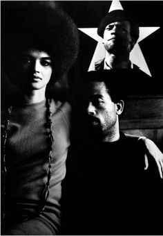 "kvetchlandia: ""Gordon Parks Kathleen and Eldridge Cleaver with Portrait of Huey Newton, Algiers 1970 "" pretty sure this is NYC . ETA: original poster says it isn't NYC. Oops. I'm keeping it up because..."
