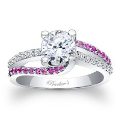 Engagement Ring With Pink Sapphires - 7677LPSW - A classic design with a unique flair, this pink sapphire and diamond engagement ring features a prong set round diamond center. The shank is adorned with a ridge of shared prong set pink sapphires swirling on opposing ridges, while a ridge of white diamonds appears to run through the middle for an elegant touch of drama. Also available in 18k and Platinum.