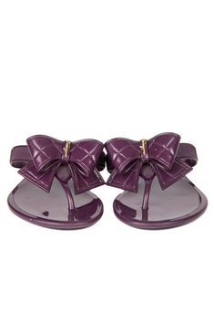 ac29510ba4e2 Step into summer in style with these Ferragamo jelly sandals! The Bali  features a quilted bow and gold logo to create the perfect pair of luxury flip  flops.
