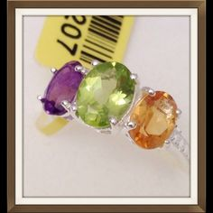 Multi Gemstone 3 Stone Ring Multi Gemstone 3 Stone Ring in .925 Sterling Silver Nickel Free (Size 6) TGW 2.370 CTs. This pretty ring features Amethyst, Citrine and Peridot. Jewelry