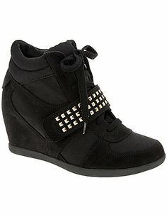 The hottest streetwear look of the year is here - the studded wedge sneaker. The sneaker goes to new heights in this fierce, feminine style, featuring goldtone studs on black faux suede for edgy contrast. Tie-front closure with a Velcro cross-strap. Comfortable wide widths with a non-slip sole. lanebryant.com