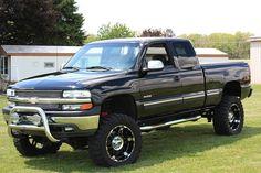 Chevy Silverado Lifted Black with nice rims Lifted Chevy Trucks, Gm Trucks, Chevrolet Trucks, Diesel Trucks, Pickup Trucks, 2002 Chevy Silverado, 2014 Chevy, Chevy 4x4, Silverado 1500