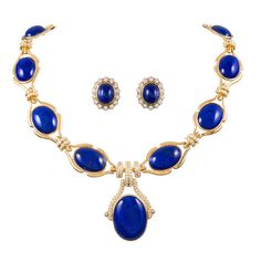 Lapis Diamond Necklace and Earrings Suite. Royal blue cabochon lapis lazuli, each encircled in 18k yellow gold in a stylized bezel and connected by double rows of diamonds and punctuated by a larger lapis drop. 20th century
