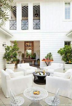 White armchair garden set outdoors space, chic and elegant all white scheme