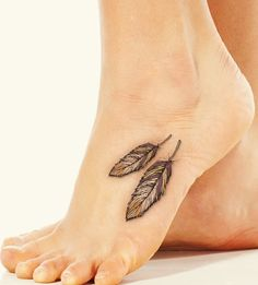 indian feathers tattoo on foot