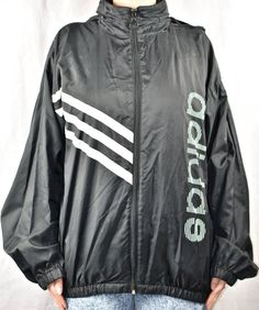 This jacket has a few very faint small stains on the bottom right of the front. There also a stain on the top left that can probably be washed off. There is no size tag so please use measurements: Length from under back collar to bottom of windbreaker: 26 inches Width from