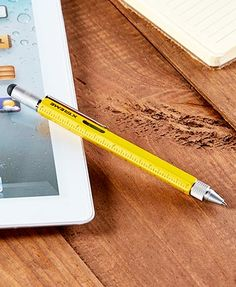 """Easily navigate your electronic device with this 6-In-1 Stylus Pen. It works with any touchscreen device and glides smoothly without leaving smudges. The stylus also functions as a black-ink pen and as a multipurpose tool for DIY projects. 6""""L. Metal and"""