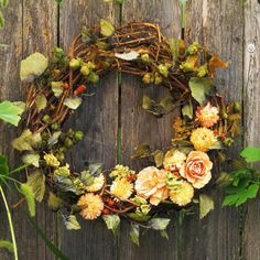 Rosy Vine Wreath        Give a rustic grapevine wreath a twist of style by embellishing it with a spray of silk roses and carnations. Mossy-tone green leaves finish off the look.
