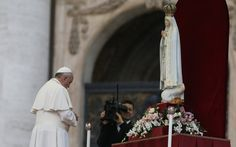 Pope Francis prays in front of the original statue of Our Lady of Fatima during a Marian vigil in St Peter's Square in 2013 (CNS)