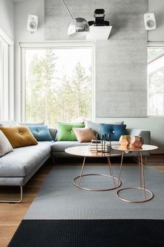 Copper side tables & modern L-shape sofa #mesadecentro