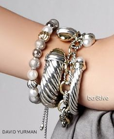Silver Stacked Bracelets by David Yurman - I'd love to be stacked with Yurman!! What an arm party going on!!!!! sigh!!!