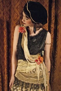 Oh wow, she is neat - gold chiffon + floral sash.