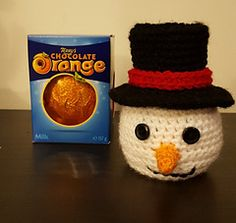 Ravelry: Chocolate Orange Snowman Top Hat Version pattern by Pip Seaton Knitted Christmas Decorations, Snowman Christmas Ornaments, Christmas Crafts, Christmas Ideas, Snow Crafts, Christmas Stuff, Diy Crafts, Christmas Knitting Patterns, Knitting Patterns Free