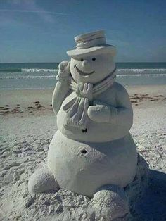 This is the nearest you will ever get to seeing snow in Florida. Sand Snowman on Clearwater Beach. Beach Christmas, Coastal Christmas, Merry Christmas, Christmas Florida, California Christmas, Michel Ciry, Sand Snowman, Snow Sculptures, Snow Art