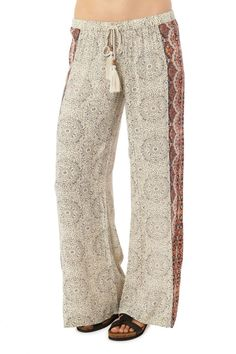"""- 100% Viscose gauze - Loose, woven pants - Allover print - Placed print on outside leg - Drawstring - 32"""" Inseam Model shown in picture is in a size small. Height: 5'9"""" Bust: 34B Waist: 25"""" Hips: 35"""""""