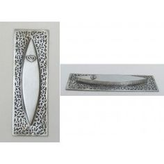 Elegantly detailed with a delicate oxidized lace pattern, this pewter mezuzah case is a lovely specimen of geometric grace. MADE IN ISRAEL. Available at www.judaicaspecialties.com