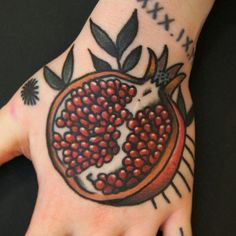 "The bold lines, looks like it will age well, but id like something a bit more ""real. And less simple? Or do simple and bold lines always run together? Conscientia pomegranate tattoo"