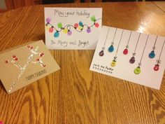 DIY Christmas Cards. Did the light strand one last year, but what about finger prints instead of buttons on the ornaments?