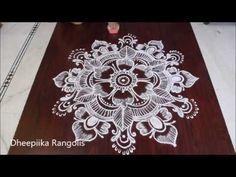 simple and easy free hand rangoli design flower rangoli kolams free hand rangolis Rangoli Designs Flower, Rangoli Kolam Designs, Rangoli Designs With Dots, Flower Rangoli, Simple Rangoli, Free Hand Rangoli Design, Bridal Mehndi Designs, Floor Art, Siri