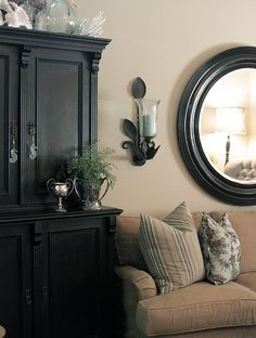 Black Furniture, tan walls, love the white accessories with glass! Niccceee