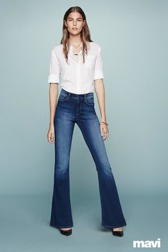 Introducing Mavi's 70's-inspired jean, Peace. This on-trend flared denim features a figure-flattering, leg-elongating silhouette that's ultra feminine and chic. Mavi's lightly stretchy material and optional distressed indigo wash makes it the ultimate denim for easy living and cool styling. Get Free Shipping & Returns Today.