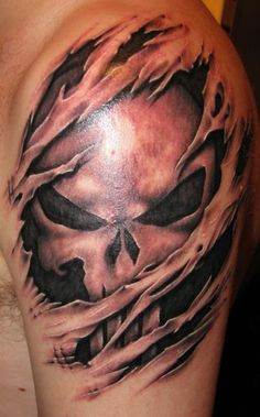 "3 different levels of edginess and fright with this tattoo.  A masterfully done skull, well... can't get much better than that.  2nd- the skull is the Punisher skull. Sweet.  And third, you have the ""torn-skin"" tattoo.  Torn skin tats are very edgy and to get a proper one, you've got to do your homework and find that artist who is heads above the rest.  I mean, hell! Look at the shading on this tattoo.  It almost brings a tear to my eye."