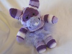 This is one of my sock animals I have listed. Isn't she cute!  Purple Fuzzy Chenille Sock Pig with Tutu. via Etsy.