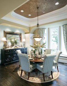 Pretty dining room...love the chairs, ceiling