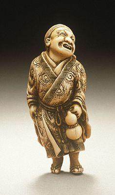 Netsuke  ~   Ryukei II (Japan)   Peddler  ~  mid- to late 19th century  Ivory with staining, sumi