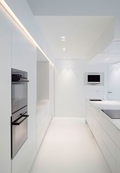 Pure lines, all-white kitchen and lighting design by Delta Light _