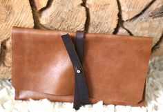 A handmade leather clutch SPECIALTY DRY GOODS  – Someday boutique Perfect for travel documents, phone & essentials while traveling or a stylish add to your everyday wardrobe