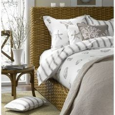 Great bedroom - love the rattan bed and the sheets.
