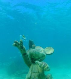 Disney's Fantasy cruise: The Mickey statue on a sunken ship appears to wave skyward in this underwater view at Disney's Castaway Cay in the Bahamas.