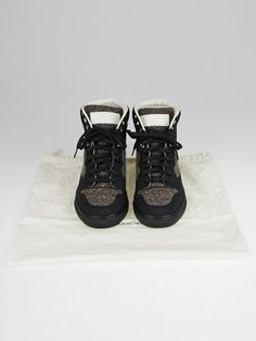 For the casual fashionista, this Balenciaga Multicolor Tweed and Black Rubber High-Top Sneakers are a classic style with a chic detail. These shoes feature sleek matte black rubber with multicolored tweed in a high-top style we love. Rubber soles and a leather lined interior make these great for wearing all day.