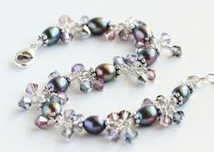 Peacock Cluster Bracelet with peacock purple/green freshwater pearls; violet, blue, pink, and silver Swarovski crystals; and sterling silver. By OpheliasJewels, $52.00